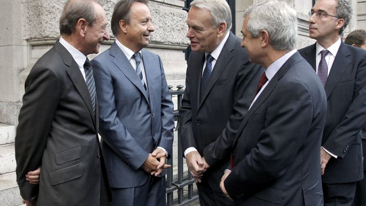 (De g. à D.) Bertrand Delanoë, Jean-Pierre Bel,Jean-Marc Ayrault etClaude Bartoloneà laSorbonneàParis, le5 octobre 2012. (GONZALO FUENTES / AFP)