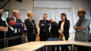 La ministre de la Santé Agnès Buzyn, son homologue de la Transition écologique, Elisabeth Borne, et le préfet de Seine-Maritime, Pierre-Andre Durand, lors d'un point presse sur l'incendie de l'usine de Lubrizol au Petit-Quevilly, le 27 septembre 2019. (LOU BENOIST / AFP)