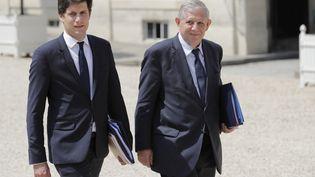 Le ministre de la Cohésion des Territoires Jacques Mézard (à droite) et son secrétaire d'Etat Julien Denormandie, le 22 juin 2017 au palais de l'Elysée.  (THOMAS SAMSON / AFP)