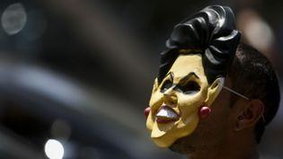 Un manifestant lors d'une mobilisation pour demander la destitution de Dilma Rousseff, le 19 mars 2016, à SaoPaulo, au Brésil. (MIGUEL SCHINCARIOL / AFP)
