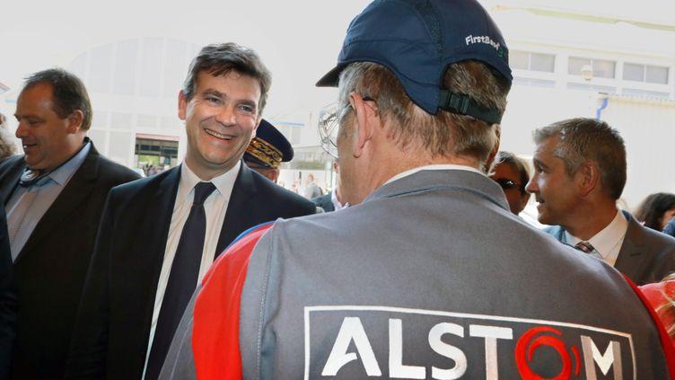 Le ministre de l'Economie Arnaud Montebourg lors d'une visite de l'usine d'Alstom du Creusot (Saône-et-Loire), le 25 juin 2014. (PHILIPPE MERLE / AFP)