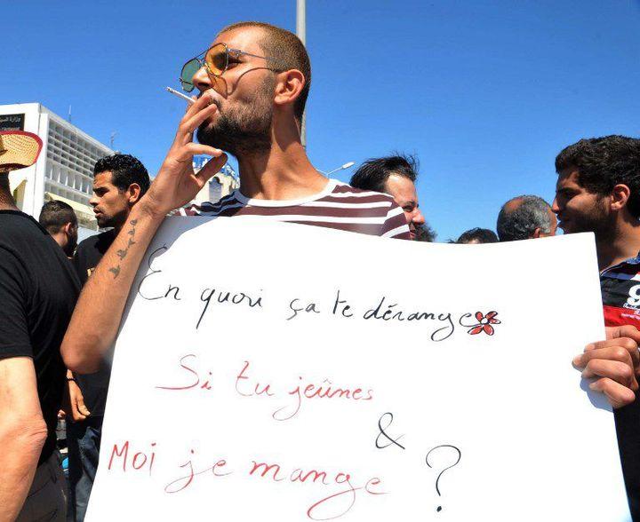 Dans la manifestation anti-jeûneurs à Tunis le 11 juin 2017... (AFP - SOFIENNE HAMDAOUI )