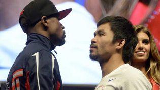 (Floyd Mayweather Jr (gauche) et Manny Pacquiao (droite) © Maxppp)