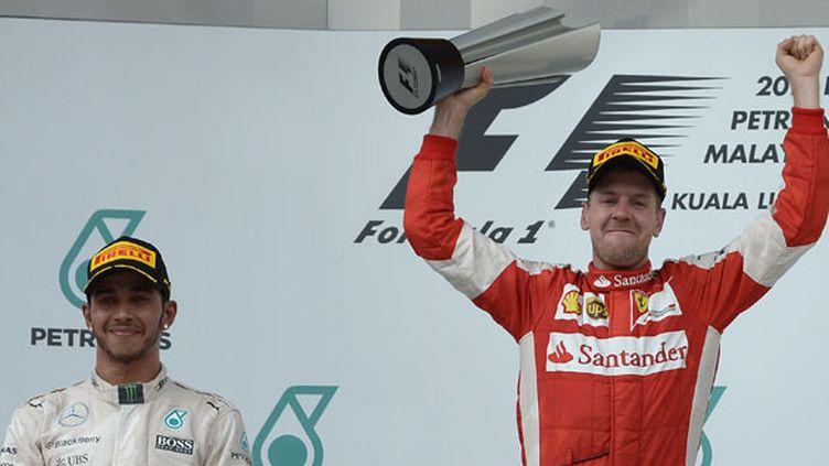 Le pilote allemand Sebastian Vettel a remporté sur Ferrari le GP de Malaisie devant Lewis Hamilton