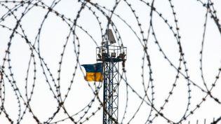 Le site de construction d'un mur fait long de la frontière de l'Ukraine avec la Russie, près de Goptivka, au nord de Kharkov, est de l'Ukraine le 15 Octobre 2014 (SOFIA BODOK / ANADOLU AGENCY / AFP)