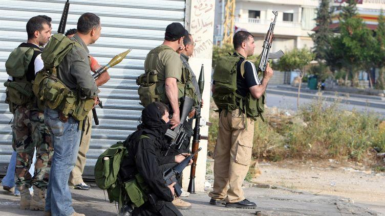 Des combattants du Hezbollah, au sud-est de Beyrouth (Liban), le 11 mai 2008. (RAMZI HAIDAR / AFP)
