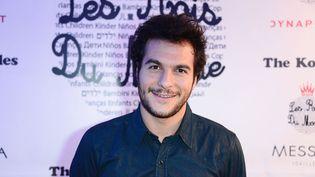 Le chanteur Amir Haddad, représentant de la France à l'Eurovision 2016, le 1er février 2016 à Paris. (LAURENT BENHAMOU / SIPA)