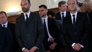 Edouard Philippe et Emmanuel Macron participent à la messe d'hommage à Jacques Hamel, un an après sa mort, à Saint-Etienne-du-Rouvray (Seine-Maritime), le 26 juillet 2017. (CHARLY TRIBALLEAU / AFP)