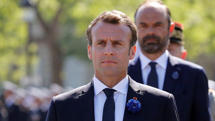 Emmanuel Macron et Edouard Philippe, lors de la cérémonie du 8-Mai, le 8 mai 2018 à Paris. (FRANCOIS GUILLOT / AFP)