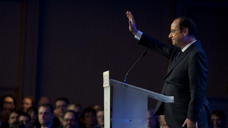 François Hollande termine un discours devant la communauté française installée à San Francisco (Californie), mercredi 12 février 2014. (ALAIN JOCARD / AFP)
