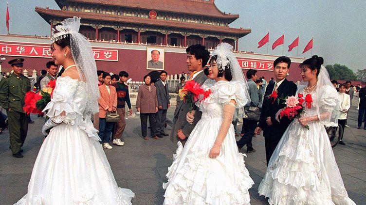 Les chinois accordent une grand place au au mariage, comme ici place Tianamen à Pékin (Reuters/ Will Burgess)