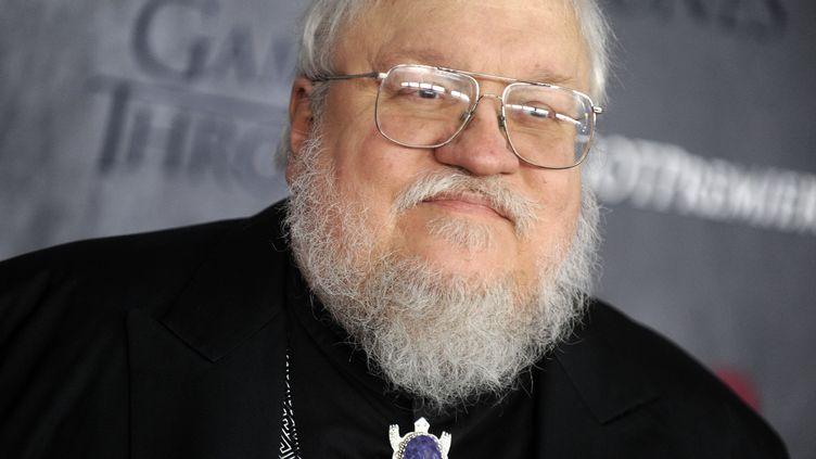 """L'auteur de la saga """"A Song of Ice and Fire"""", lors de l'avant-première de la saison 4 de """"Game of Thrones"""", à New York, le 18 mars 2014. (DENNIS VAN TINE / GEISLER-FOTOPRESS / AFP)"""