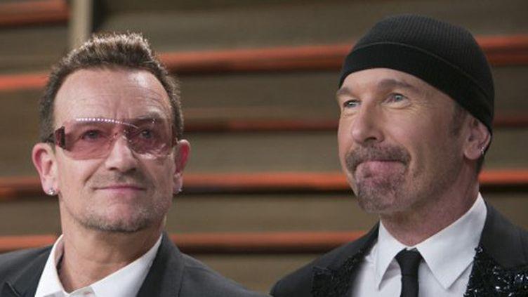 Bono et The Edge de U2 en février 2014.  (Adrian Sanchez-Gonzalez / AFP)