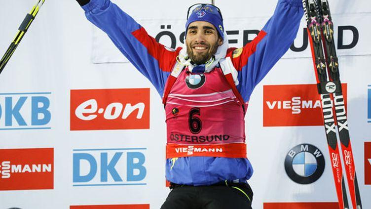 Le sourire victorieux de Martin Fourcade sur le podium à Östersund