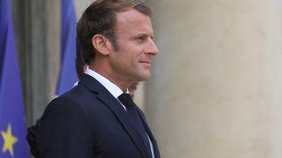 Emmanuel Macron a durci le ton sur la question migratoire, à 15 jours d'un débat sur l'immigration au Parlement. (LUDOVIC MARIN / AFP)