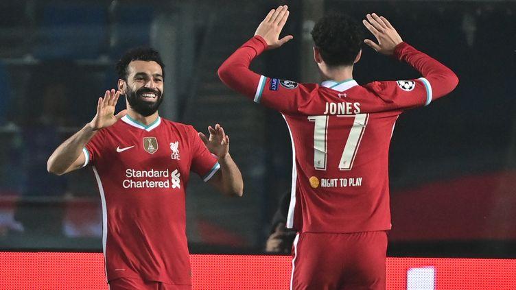 Mohamed Salah fête son but, le 21e avec Liverpool en Ligue des Champions. (MIGUEL MEDINA / AFP)