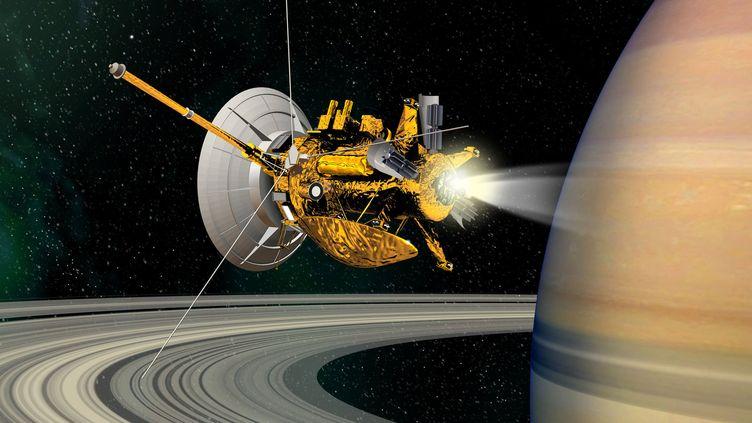 Vue d'artiste de la sonde Cassini lors de sa mise en orbite autour de Saturne, diffusée le 2 mai 2017. (ESA / CNES / D.DUCROS / AFP)