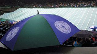 En raison de la crise du coronavirus, le tournoi de Wimbledon a été annulé. Ici, une photo montrant une suspension de match en raison de la pluie. (SVEN SIMON / SVEN SIMON)