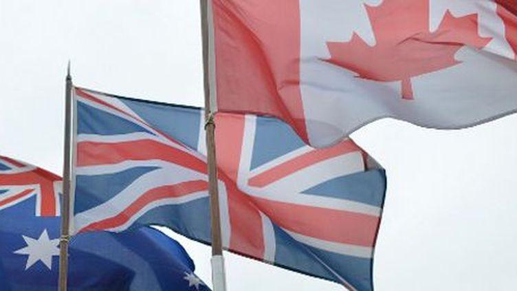 Drapeaux australien, britannique et canadien (ARTUR WIDAK / NURPHOTO)