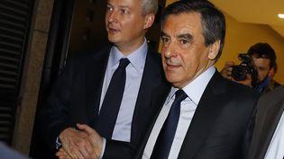 Bruno Le Maire et François Fillon au second tour de la primaire de la droite, le 27 novembre 2016. (PATRICK KOVARIK / AFP)