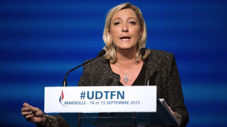 La présidente du Front national, Marine Le Pen, le 15 septembre 2013 à l'université d'été du FN, à Marseille (Bouches-du-Rhône). (BERTRAND LANGLOIS / AFP)