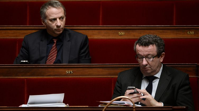 Les députés PS Laurent Baumel et Christian Paul, à l'Assemblée nationale, le 13 février 2015. (STEPHANE DE SAKUTIN / AFP)