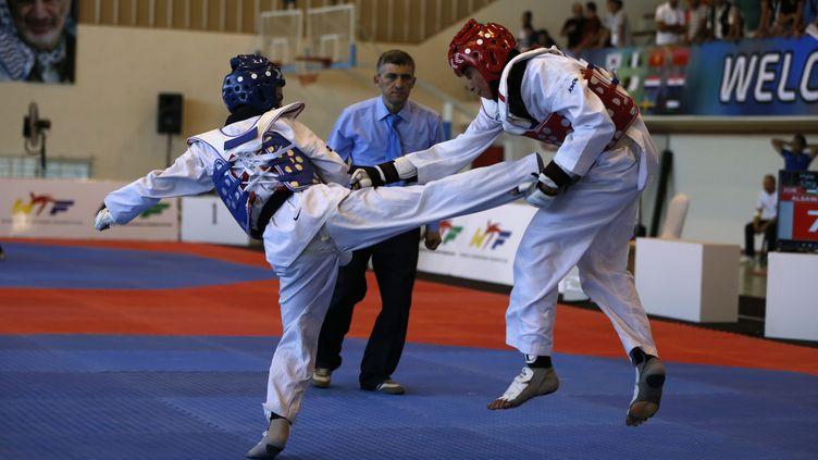 Un combatlors d'une compétition de taekwondo à Ramallah,en Cisjordanie occupée, le 18 juillet 2016. (ABBAS MOMANI / AFP)