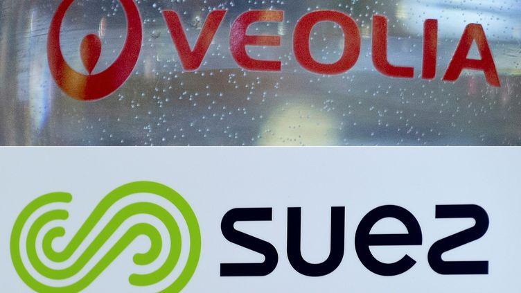 Engie, l'actionnaire principal de Suez, a finalement accepté de vendre ses parts à Veolia, malgré le désaccord de l'Etat. (KENZO TRIBOUILLARD / AFP)