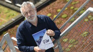 """L'auteur de BD Jean-Marc Rochette, auteur de de l'album """"Le loup"""", à Bruxelles, en juin 2019. (JOHN THYS / AFP)"""