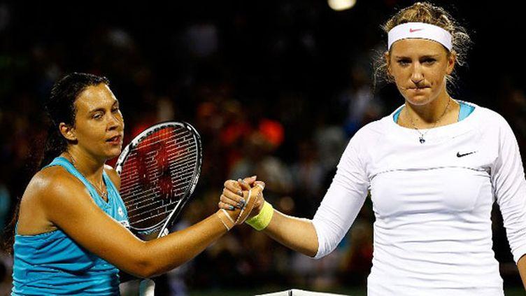 Marion Bartoli (à gauche) et Victoria Azarenka (à droite)