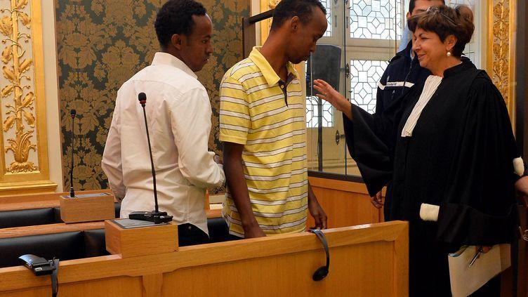 Deux des pirates somaliens lors de leur procès à Rennes (Ille-et-Vilaine) le 14 octobre 2013. (MAXPPP)