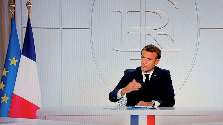 Le président de la République, Emmanuel Macron, lors d'une allocution télévisée, le 14 octobre 2020. (Ludovic MARIN / AFP)