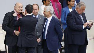 Jean-Marie Le Guen, Manuel Valls, Jean-Jacques Urvoas et Claude Bartolone lors du défilé du 14-Juillet, à Paris. (PATRICK KOVARIK / AFP)