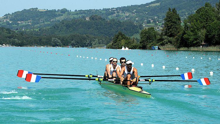 Franck Solforosi, Thomas Baroukh, Thibault Colard et Guillaume Raineau ont décroché la médaille de bronze. (JEAN-PIERRE CLATOT / AFP)