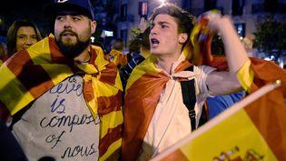 Des manifestants dans les rues de Barcelone, le 4 octobre 2017. (LLUIS GENE / AFP)