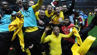 Les joueurs de Quevilly fêtent leur qualification en finale de la Coup de France, le 11 avril 2012 contre Rennes. (JEAN-FRANCOIS MONIER / AFP)