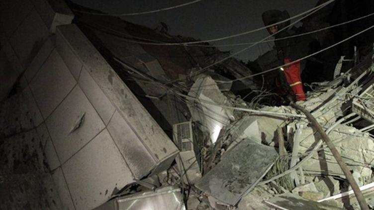 Bâtiment de la résidence de Mouammar Kadhafi, détruit lors d'un raid aérien dans la nuit du 24 au 25 avril 2011 (AFP - JOSEPH EID)