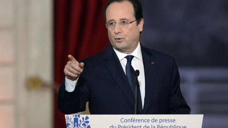 François Hollande, le 14 janvier 2014, lors de sa conférence de presse à l'Elysée. (ALAIN JOCARD / AFP)