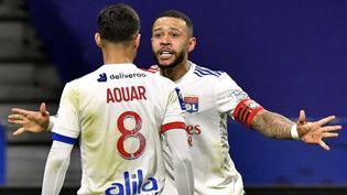 Houssem Aouar se réjouit après un but marqué, àDecines-Charpieu (Rhône) le 3 mars 2021. (PHILIPPE DESMAZES / AFP)