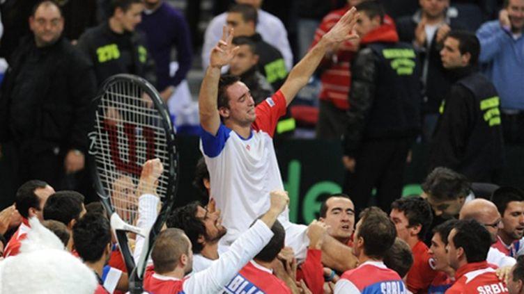 Troicki porté en triomphe (ANDREJ ISAKOVIC / AFP)
