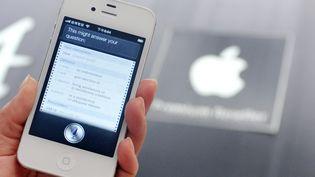 Siri est le logiciel d'assistance vocale des téléphones d'Apple. (MANDY CHENG / AFP)