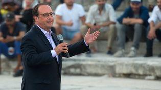 François Hollande, le 21 juillet 2017, à Arles (Bouches-du-Rhône), lors dusommet des Napoleons, un réseau d'acteurs de l'innovation. (BERTRAND LANGLOIS / AFP)