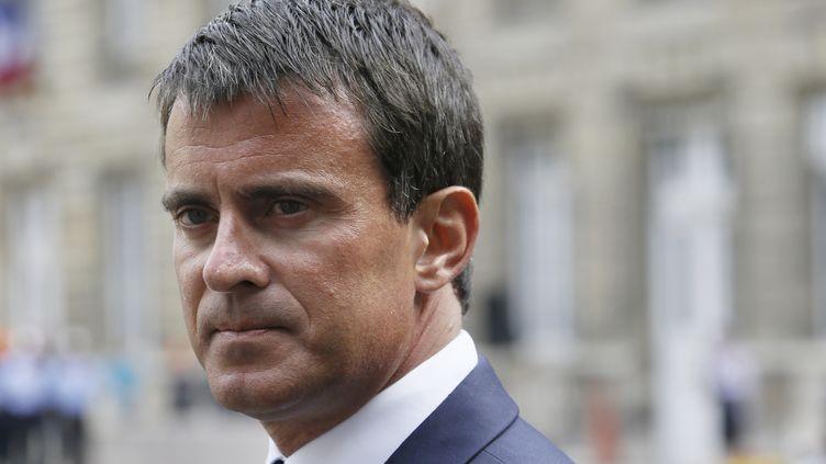 Le Premier ministre, Manuel Valls, le 19 août 2014, à Paris. (PATRICK KOVARIK / AFP)