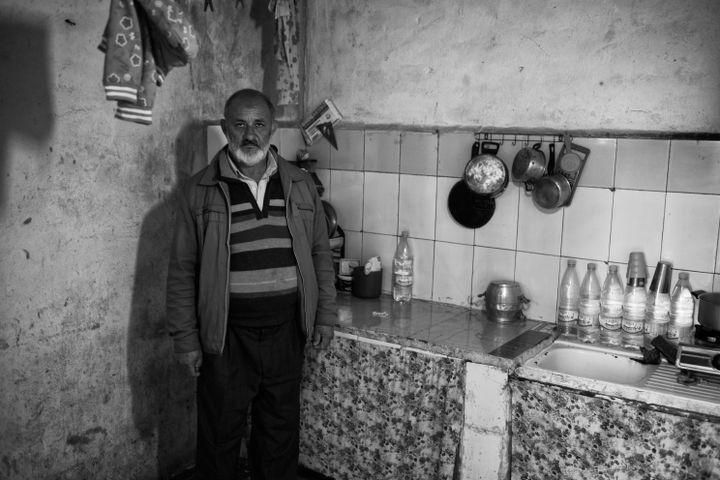 """""""Omar est un peu le chef du bidonville, il y vit depuis 1990. Son regard est triste, sans illusions, presque accusateur. Il me conduit, me montre la misère, celle qu'il partage avec les autres habitants."""" (LOTFI   MOKDAD)"""