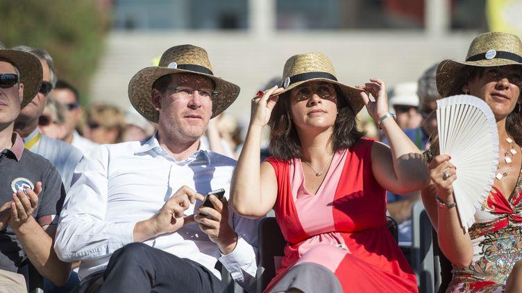 Les deux ministres écologistes Pascal Canfin et Cécile Duflot, lors des journées d'été d'EELV, le 22 août 2013 à Marseille (Bouches-du-Rhône). ( MAXPPP)