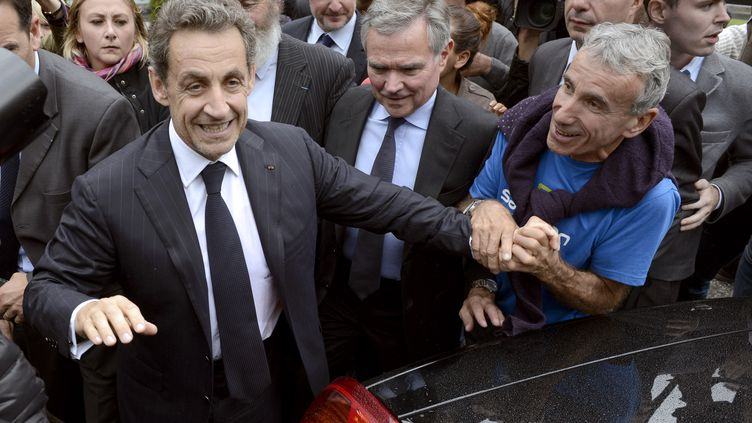 L'ancien président de la République, Nicolas Sarkozy, le 18 septembre 2013 au Petit-Bornand (Haute-Savoie). (PHILIPPE DESMAZES / AFP)