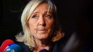 La présidente du RN, Marine Le Pen, répond à la presse sur la réforme des retraites, à Hénin-Beaumont (Pas-de-Calais), le 11 décembre 2019. (DENIS CHARLET / AFP)