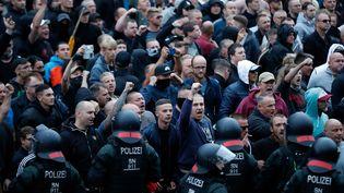 La police sécurise une manifestation d'extrême droite, à Chemnitz (Saxe, Allemagne), le 27 août 2018. (ODD ANDERSEN / AFP)