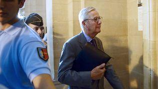 Denis Gautier-Sauvagnac, ex-président de l'UIMM, quitte le tribunal correctionnel après une audience, le 7 octobre 2013 à Paris. (ERIC FEFERBERG / AFP)