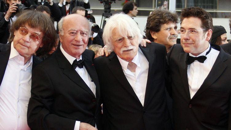 """Cabu, Wolinski, Cavanna et Tignous au festival de Cannes de 2008 lors de la projection de """"C'est dur d'être aimé par des cons""""  (François Guillot / AFP)"""